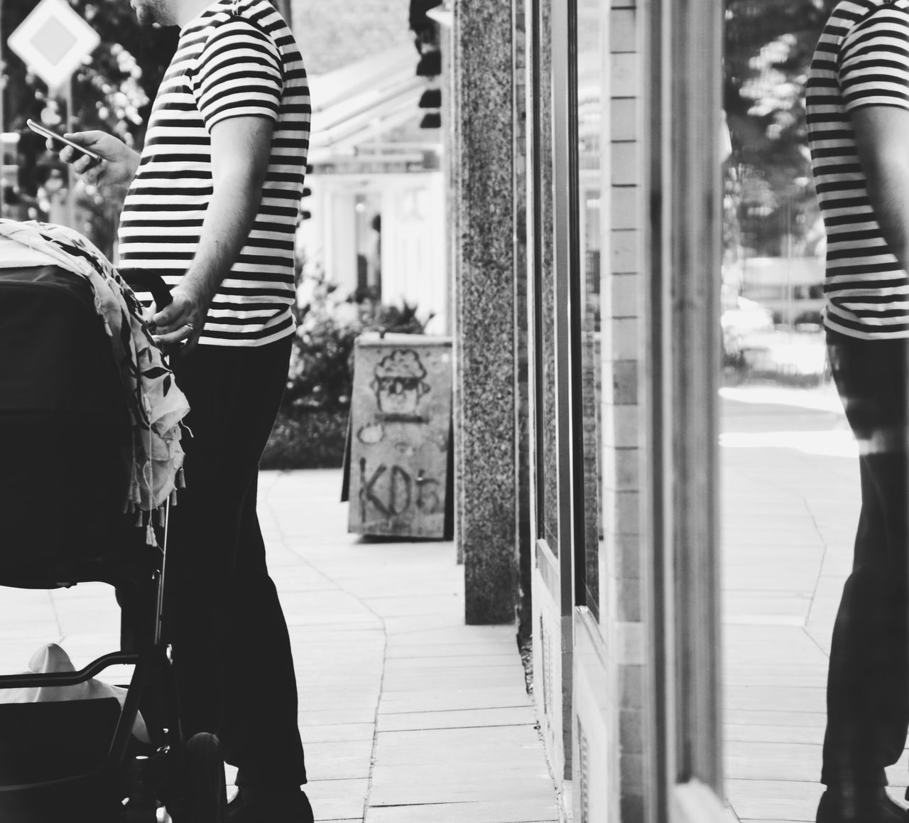 real people, striped, pregnant, two people, rear view, standing, midsection, casual clothing, women, focus on foreground, walking, leisure activity, day, lifestyles, indoors, togetherness, low section, young women, close-up, adult, people