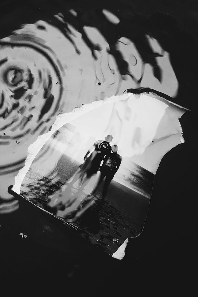 How to recycle an accidentally torned picture? Use it as a subject and be creative.. Eyeem Philippines Jayarro2016photography Black And White Photography B&w Street Photography Eyeemphoto People Together Silhouette Photography