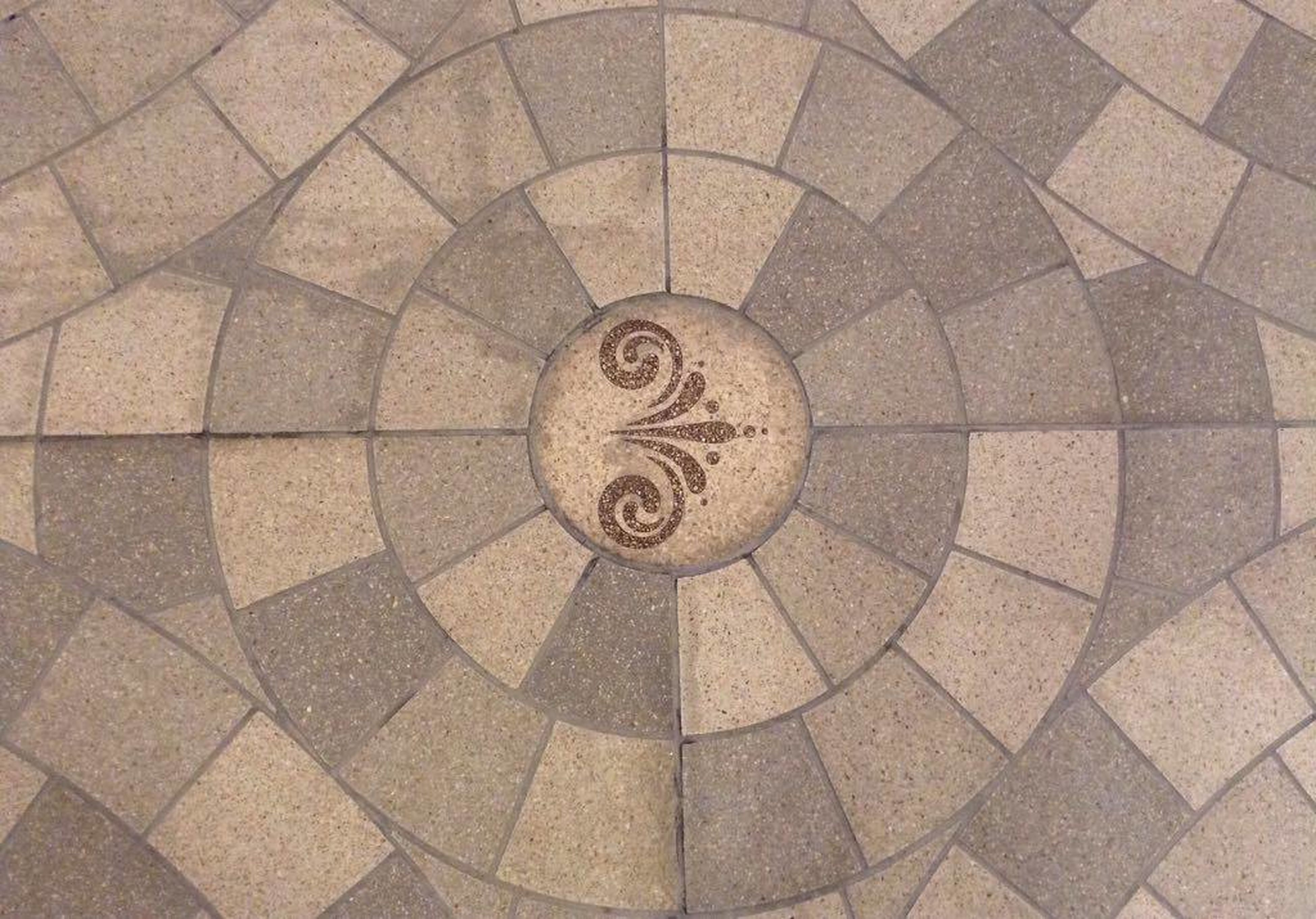 flooring, tiled floor, indoors, backgrounds, pattern, design, full frame, repetition, floor, geometric shape, circle, paving stone, architectural feature, tile floor, history, stone tile, no people, stone material, interiors, arrangement