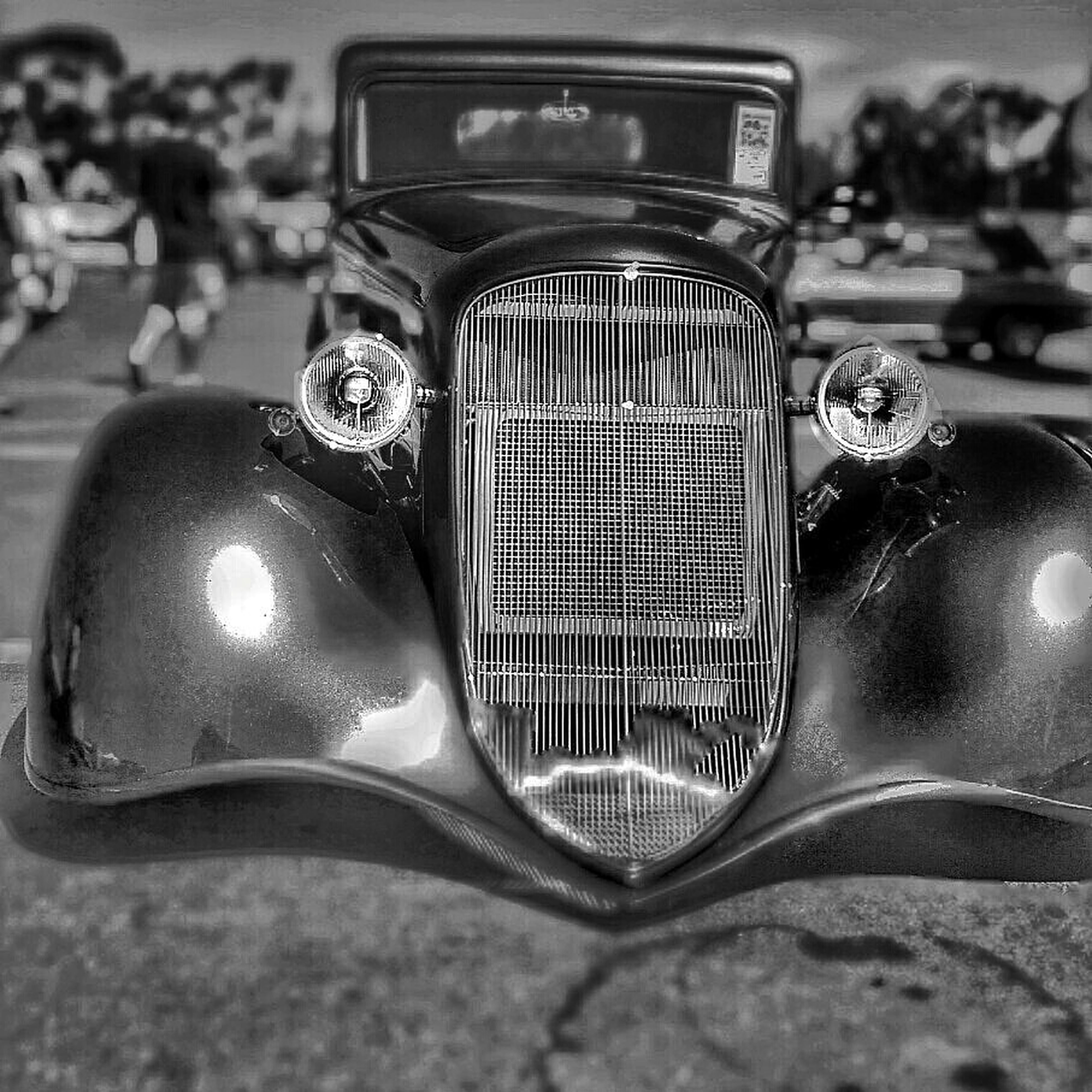 close-up, focus on foreground, old-fashioned, retro styled, car, indoors, still life, reflection, selective focus, metal, land vehicle, shiny, technology, music, arts culture and entertainment, headlight, no people, single object, sunglasses, antique