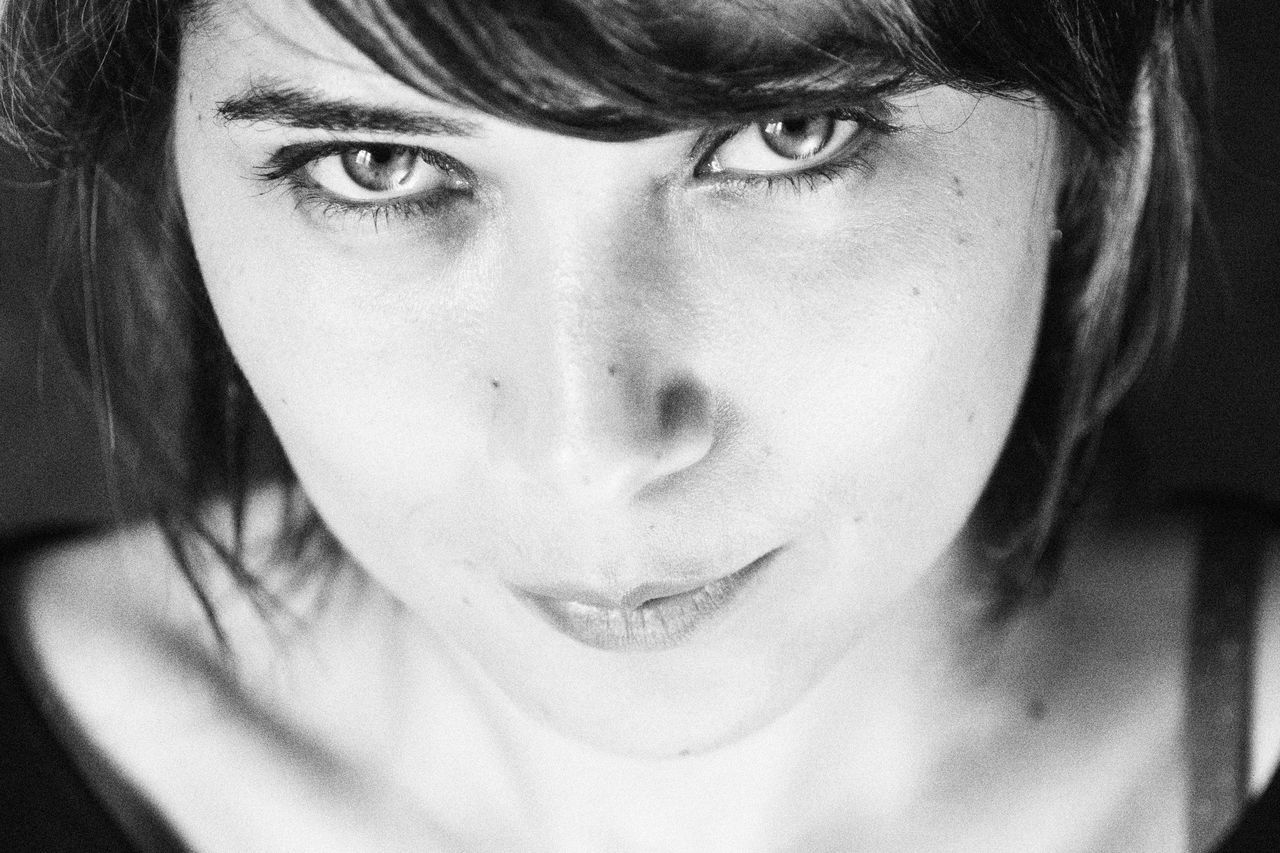 Blackandwhite Bw Close-up Composition Confidence  Contemplation Eyes Front View Head And Shoulders Headshot Human Face Lifestyles Light Look Looking At Camera Person Portrait Portrait Of A Woman Portrait, Real People Serious Young Adult