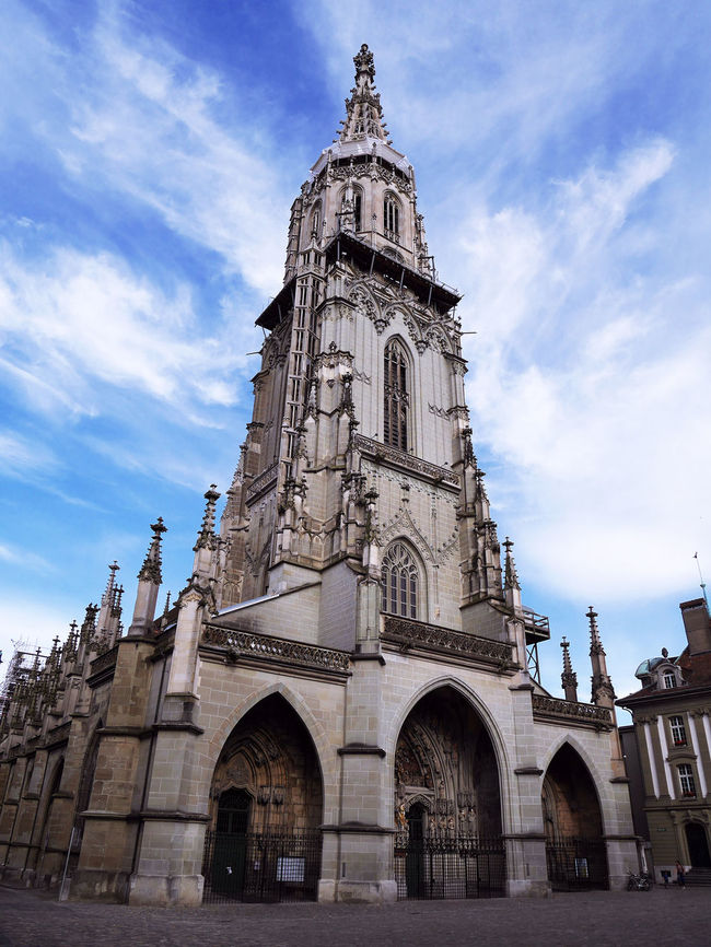 Bern Bernese Oberland Switzerland Architecture Low Angle View Building Exterior Cathedral Gothic Gothic Architecture Built Structure Arch Sky Spirituality History Façade Outdoors Architectural Feature Cloud Day Blue Summer Historical Building Architecture