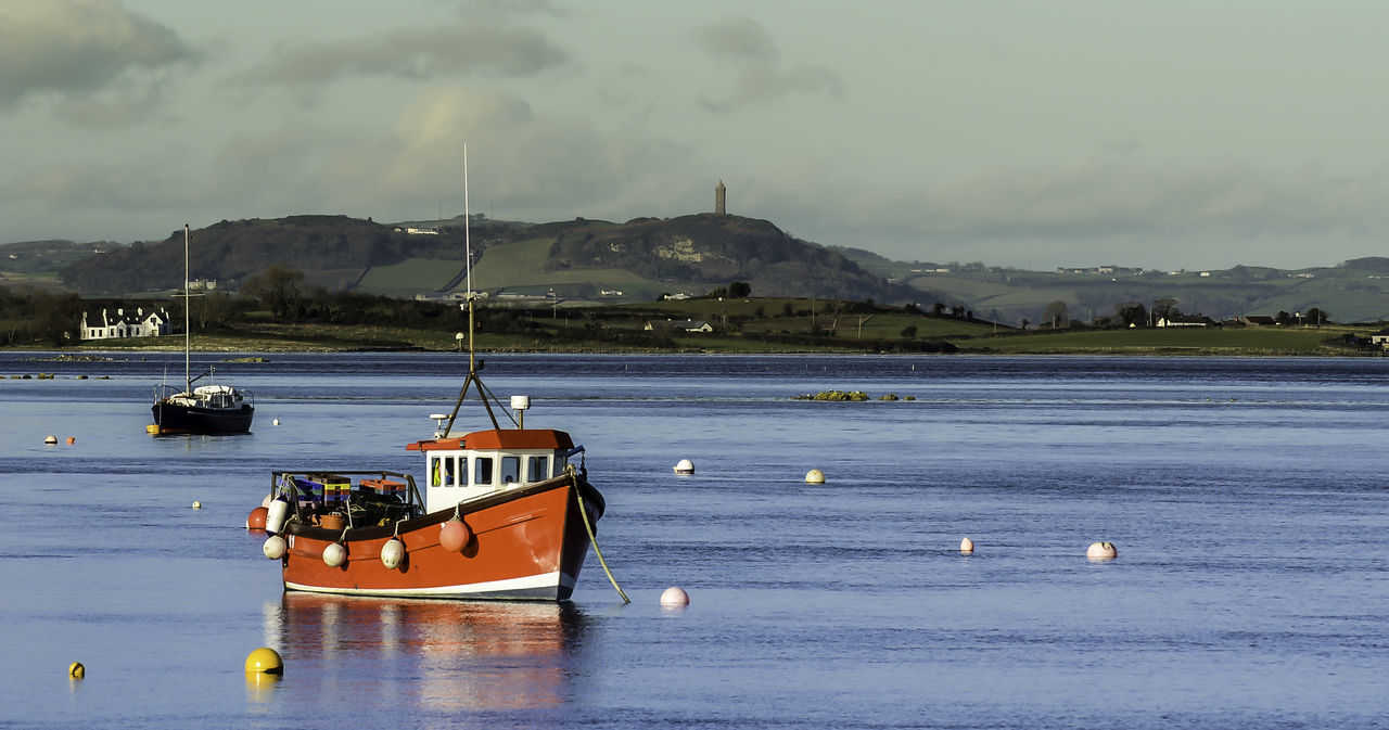 Little Red Fishing Boat Beauty In Nature Bouys Day Fishing Boat Landscape Mountain Nautical Vessel No People Outdoors Red Sailing Scenery Sea Sea And Sky Sky Strangford Lough Transportation Travel Destinations Water