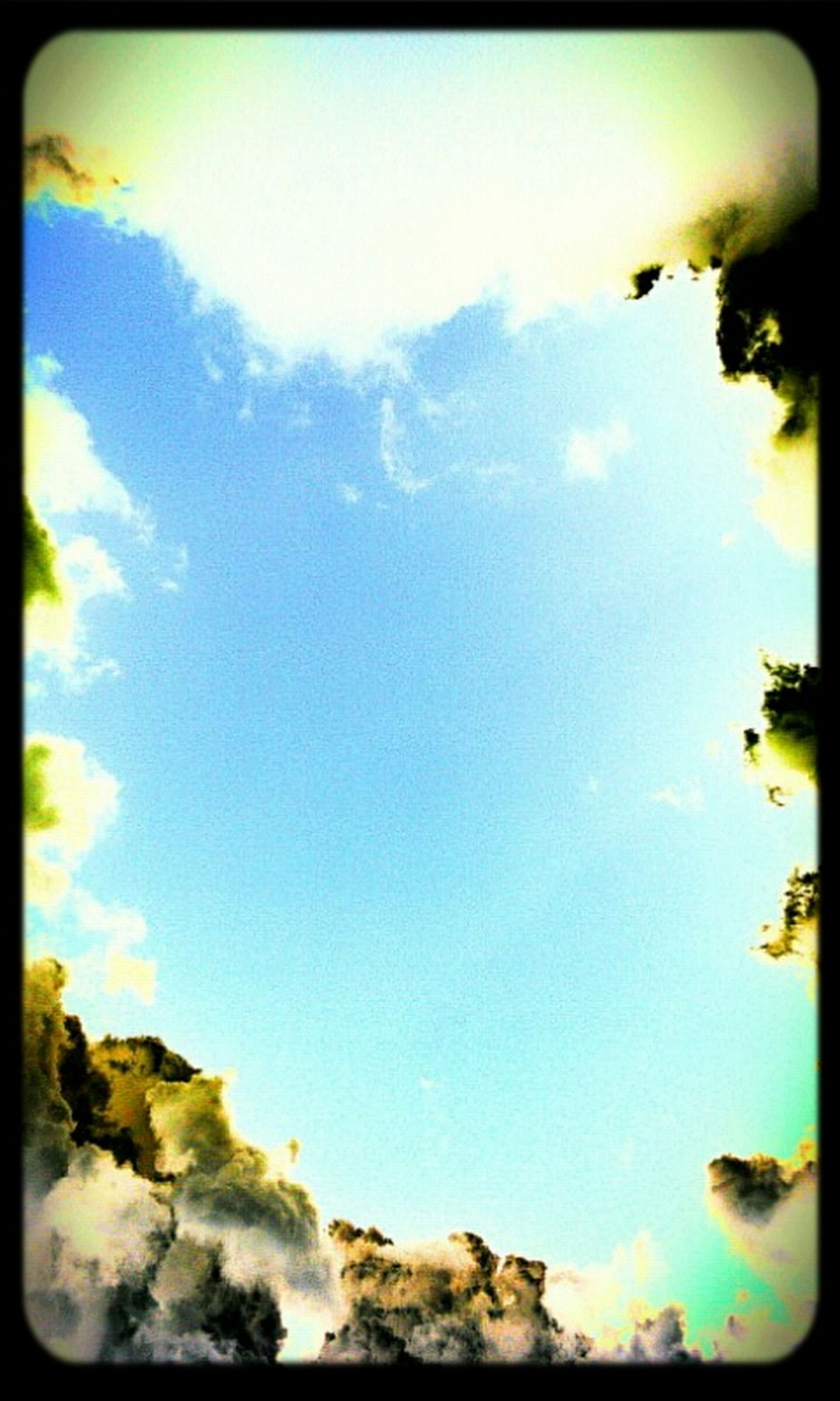 transfer print, auto post production filter, blue, low angle view, sky, beauty in nature, nature, tranquility, cloud - sky, tree, scenics, cloud, sunlight, outdoors, tranquil scene, no people, day, idyllic, growth, rock - object