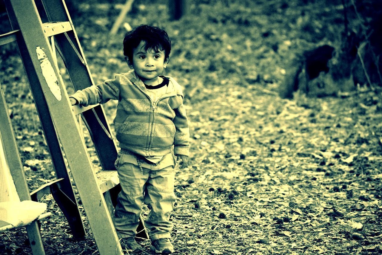 childhood, looking at camera, portrait, one person, boys, full length, children only, standing, cute, one boy only, outdoors, child, day, real people, people