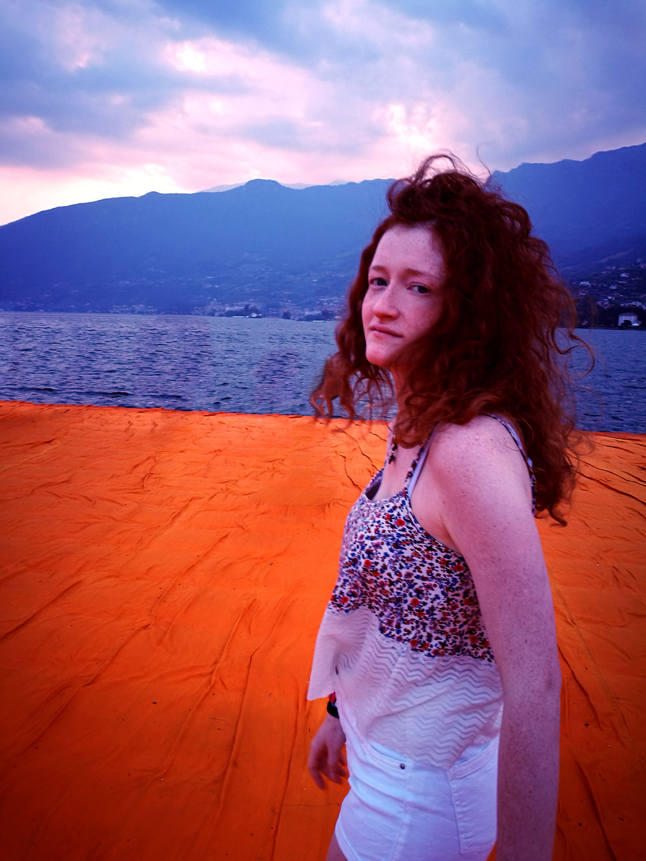 Blue Christo Floating Piers Ginger Looking At Camera Nature One Person One Woman Only Orange Outdoors Portrait Red Redhead Skinny Sunset Water