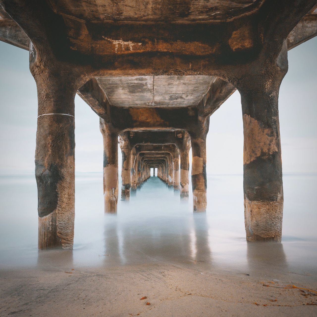 Under the Manhattan Beach pier Pier Underneath In A Row Below Sea Water Architectural Column Day No People Nature Architecture Outdoors The Great Outdoors - 2017 EyeEm Awards EyeEmNewHere Seascape California Losangeles