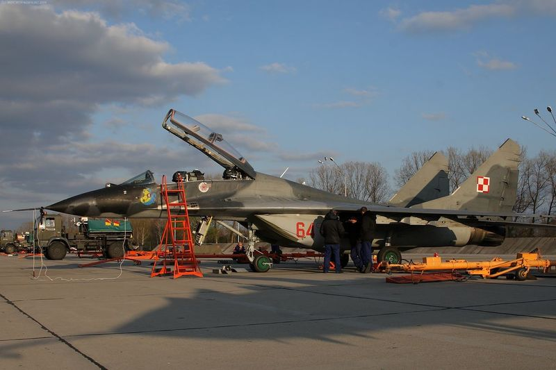 Adults Only Aerospace Industry Air Base Air Force Air Vehicle Aircraft Airplane Base Blue Sky Cloud - Sky Day Maintenance Maintenance Work Mig-29 Mikoyan I Gurevich Mikoyan Mig-29 Military Orange Outdoors People Plane Sky