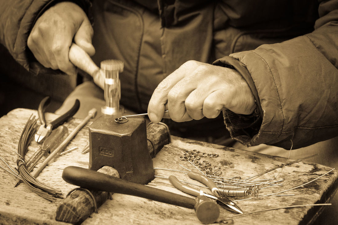 the working hands of a jeweller Hammering Hands Hands At Work Working Close-up Expertise Hammer Hand Tool Human Hand Jeweler Jeweller Jewellery Jewelry Manual Worker Movement Movement Photography Occupation One Person Skill  Skillful Work Table Work Tool Working Working Hands Workshop