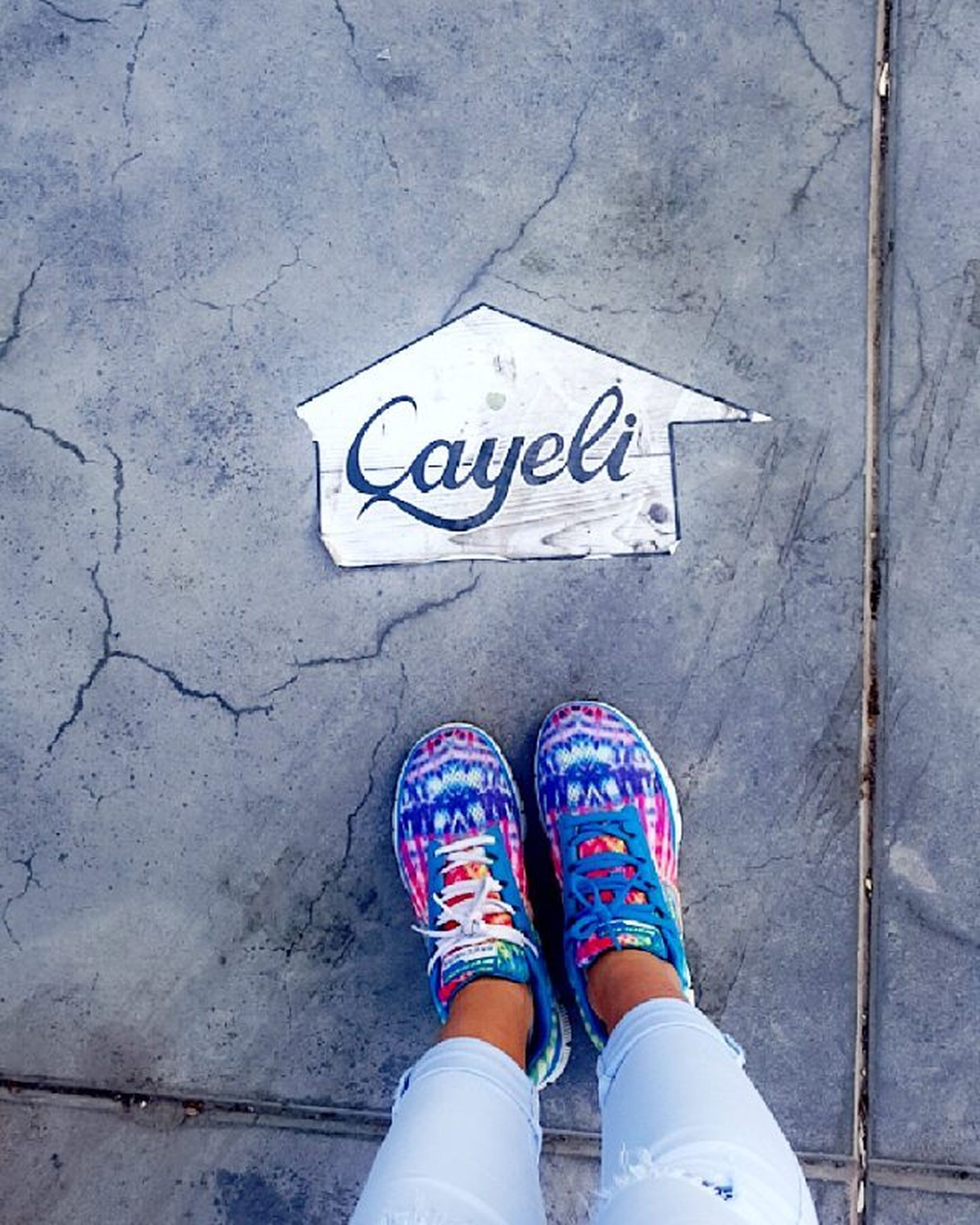 text, communication, western script, low section, shoe, personal perspective, person, standing, street, high angle view, sign, guidance, capital letter, non-western script, information, lifestyles, day
