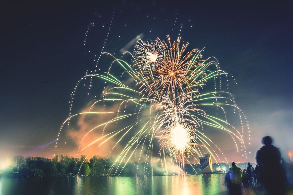 Beautiful stock photos of fireworks, Blurred Motion, Exploding, Firework - Man Made Object, Group Of People
