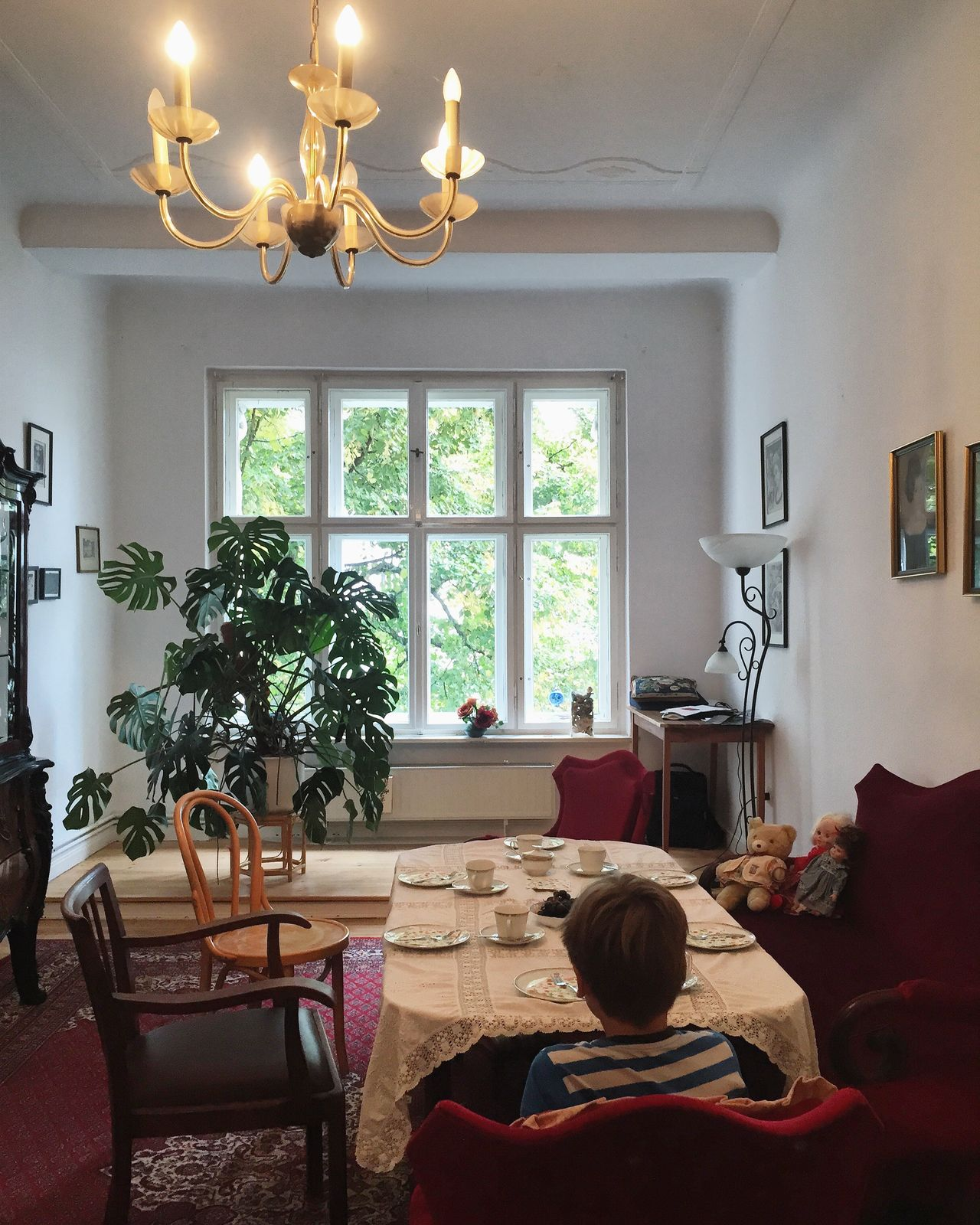 Tea time at Grandmas' Architecture Berlin Apartments Day Domestic Life Home Interior Home Showcase Interior Illuminated Indoors  Lighting Equipment Living Room Living Room Impression Old Buildings One Person Real People Set Table Sofa Tea Time Window