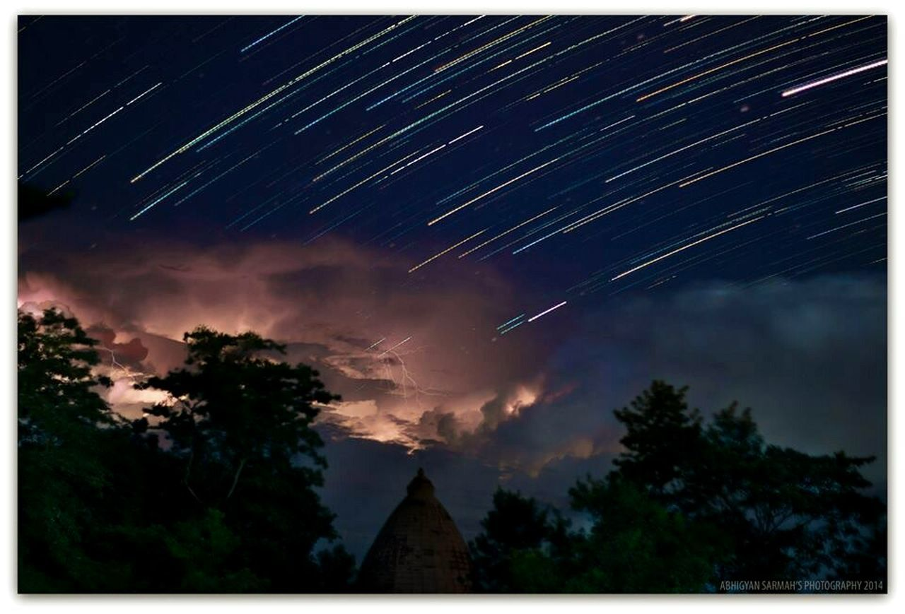 Thunder & Stars Night Star - Space Nature Astronomy Star Trail Outdoors Thunderstorm Bolts Beauty In Nature Longexposure Slowshutter World Slowshutter Startrailphotography Startrails Enjoy The New Normal Tree Milky Way Space Sky Forest No People Galaxy Constellation Landscape Treetop
