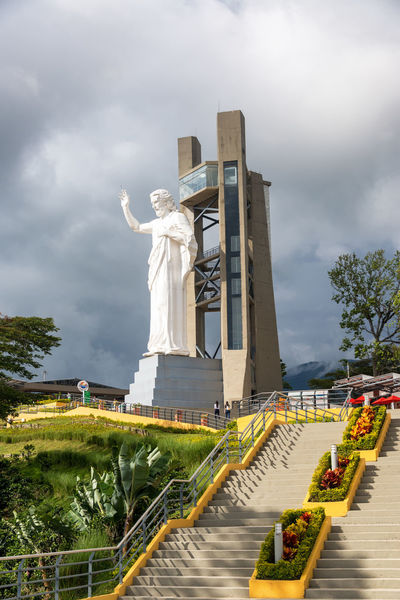 FLORIDABLANCA, COLOMBIA - MAY 3: El Santisimo statue of Jesus Christ in Floridablanca, Colombia on May 3, 2016 Architecture Bucaramanga Building Catholic Catholicism Cerro Christianity City Cloud Clouds Ecoparque Elsantisimo Floridablanca Hill Jesuschrist Landmark Mountain Religion Santander Santisimo Scupture Statue Tourism Urban White