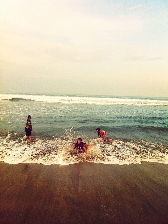 Swimming On The Kuta Beach