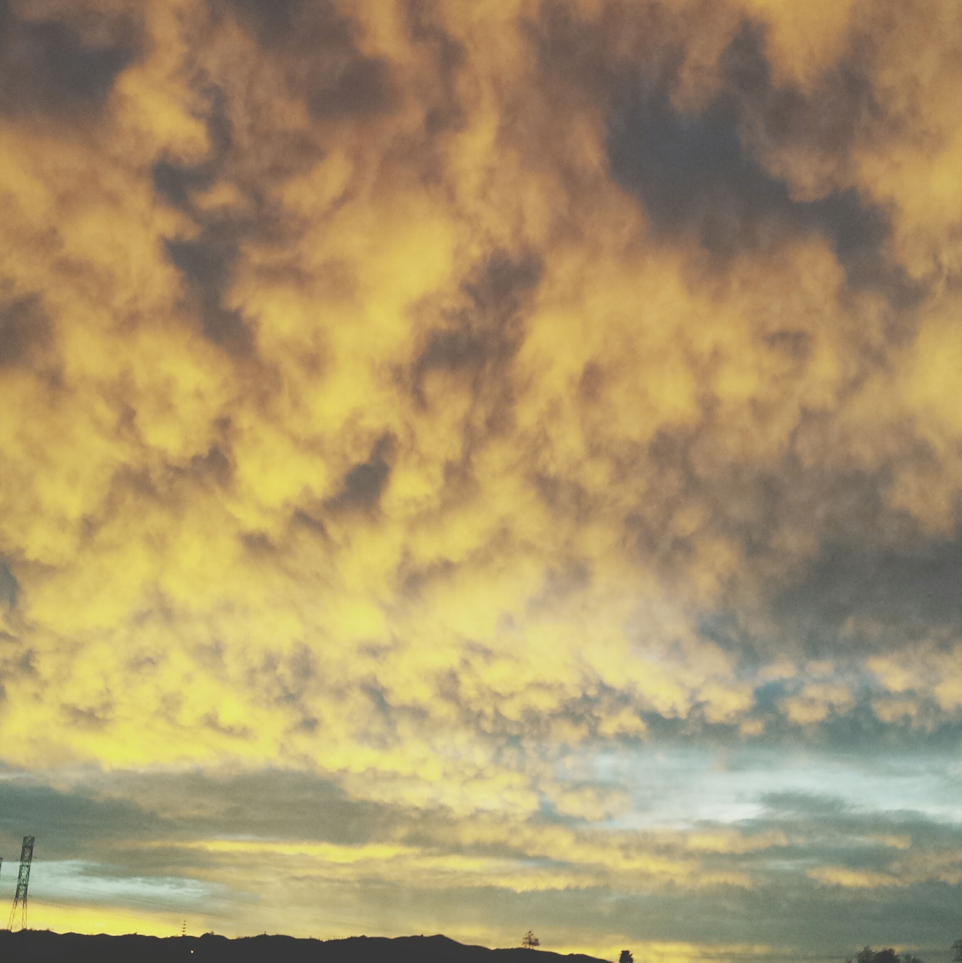 sunset, sky, cloud - sky, scenics, beauty in nature, tranquility, tranquil scene, cloudy, nature, orange color, idyllic, cloud, dramatic sky, silhouette, weather, low angle view, cloudscape, overcast, outdoors, moody sky