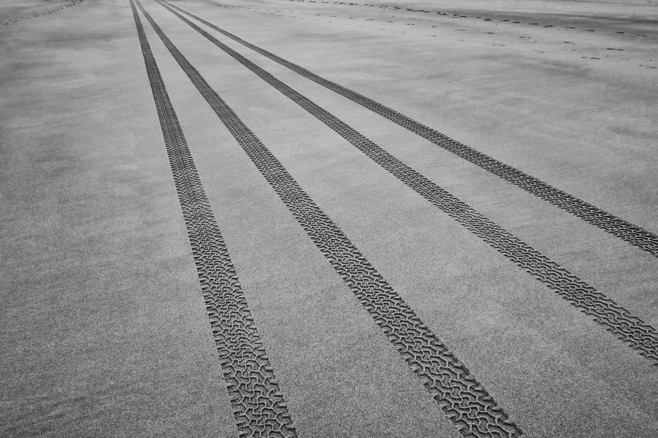 Tracks in the sand. Beach Black & White Black And White Blackandwhite Day Fine Art Fine Art Photography Fineart High Angle View Monochrome Nature Nature Nature_collection No People Outdoors Road Shadow The Way Forward Trace Traces Traces In The Sand Track Tracks In The Sand Wheel Tracks Wheels