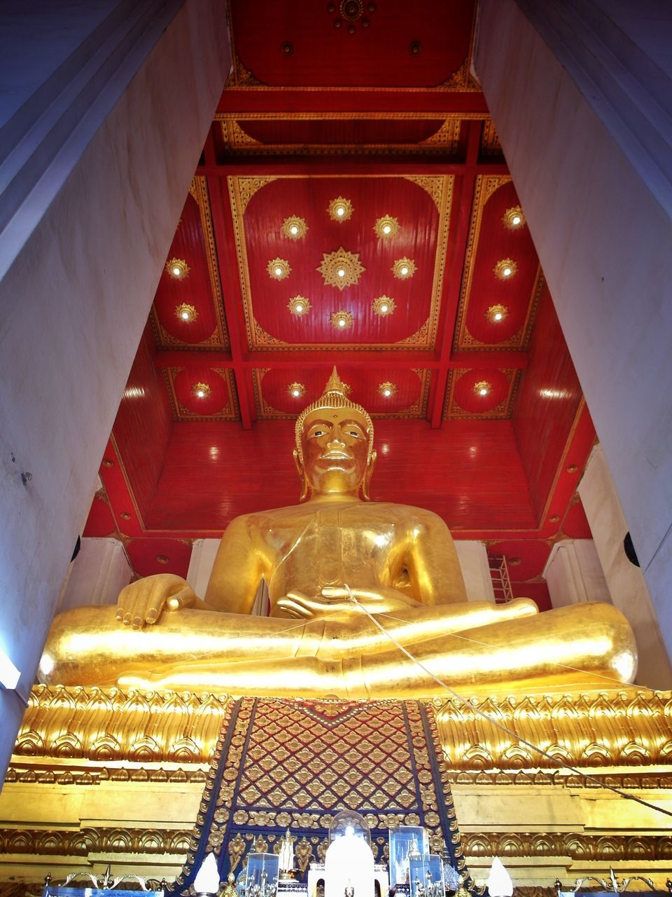 spirituality, religion, statue, low angle view, indoors, sculpture, human representation, place of worship, illuminated, gold colored, golden color, architecture, no people, day