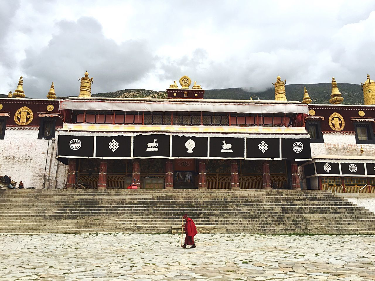 Full Length Architecture Built Structure Building Exterior Sky Steps History Façade Casual Clothing Person Day The Past Place Of Worship Cloud - Sky In Front Of Wg Tibet
