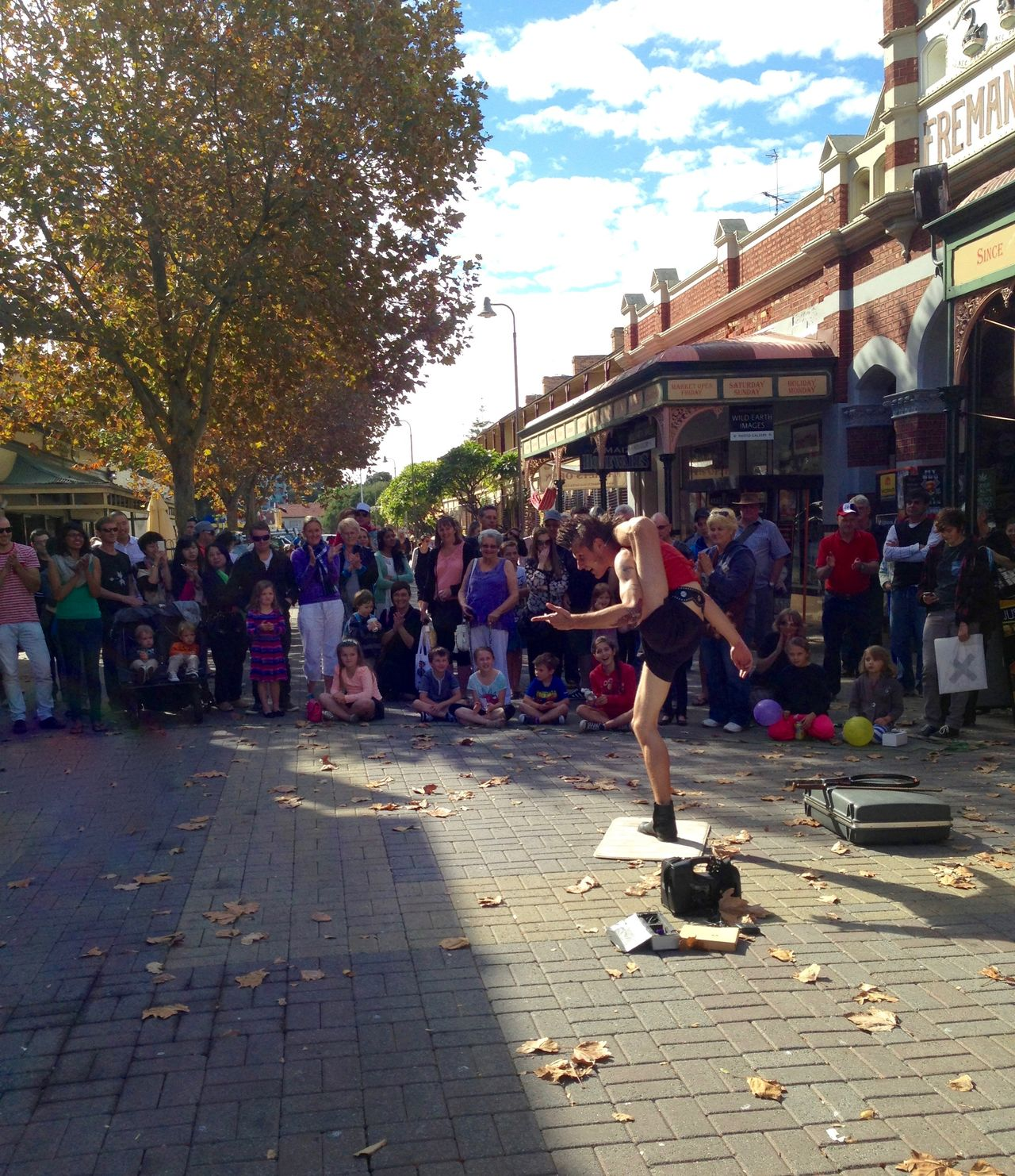 Busker outside the Fremantle Markets Architecture Artistic Expression Busker City City Life City Street Crowd Day Entertainment Flexible Fremantle, Western Australia Large Group Of People Leisure Activity Man Market Outdoors Perfomance Performer  Street Street Photography Thin Urban Urban Lifestyle