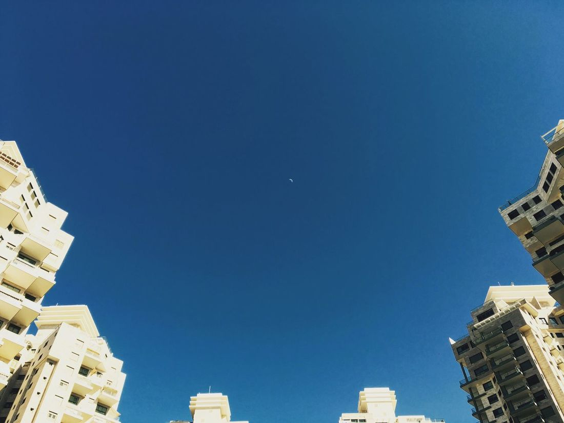 Architecture Blue Built Structure Clear Sky Low Angle View Building Exterior Copy Space City No People Outdoors Day Moon Sky