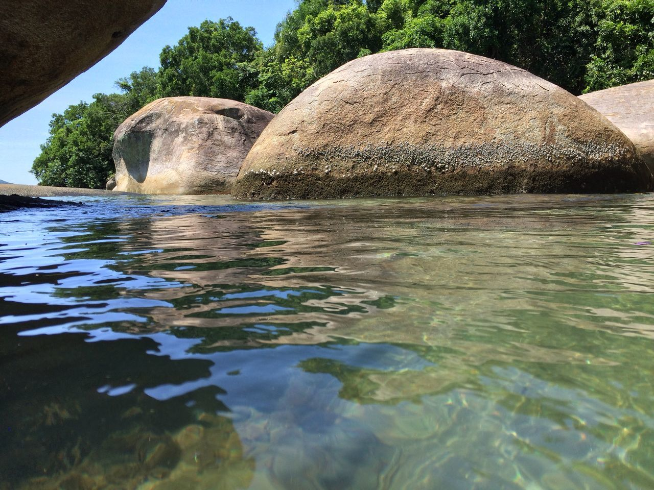rock - object, water, waterfront, day, reflection, nature, outdoors, no people, tranquility, beauty in nature, scenics, sea, tree, sky