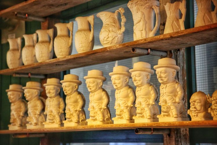 Middleport Pottery Art And Craft Day Human Representation In A Row Indoors  Large Group Of Objects Male Likeness Middleport Pottery No People Sculpture Shelf Statue Workshop