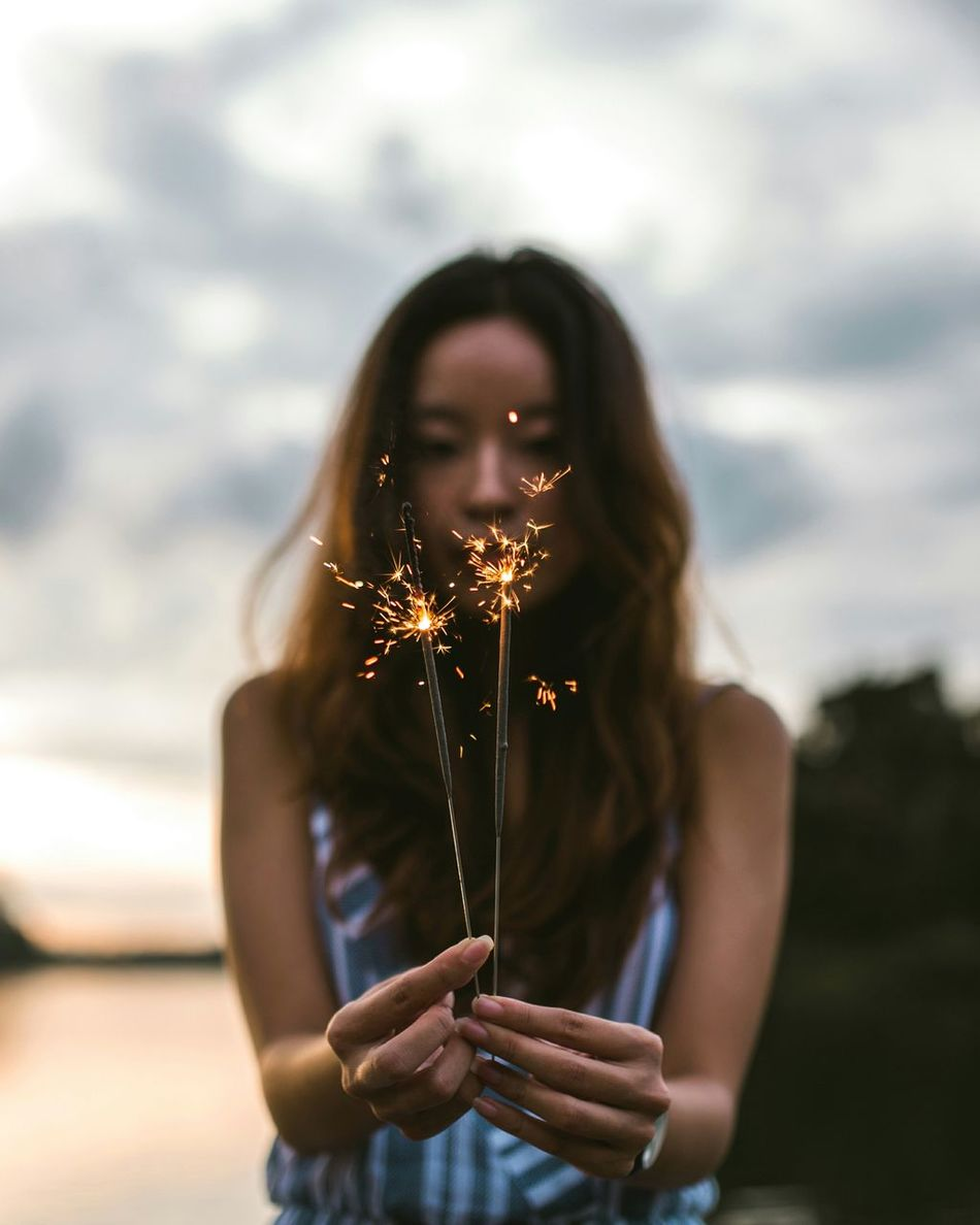 a little fire One Person Outdoors Nature Dreamlike Light Summer Beauty In Nature Sparkler Sparklers Fire Burning Burn Water Portrait Front View Moody Waist Up