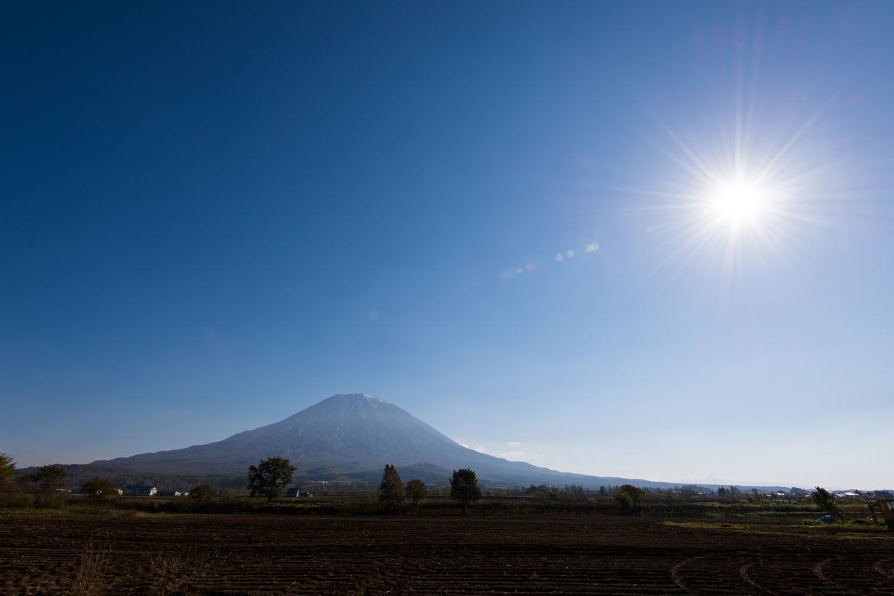 Scenic View Of Landscape Against Sky On Sunny Day
