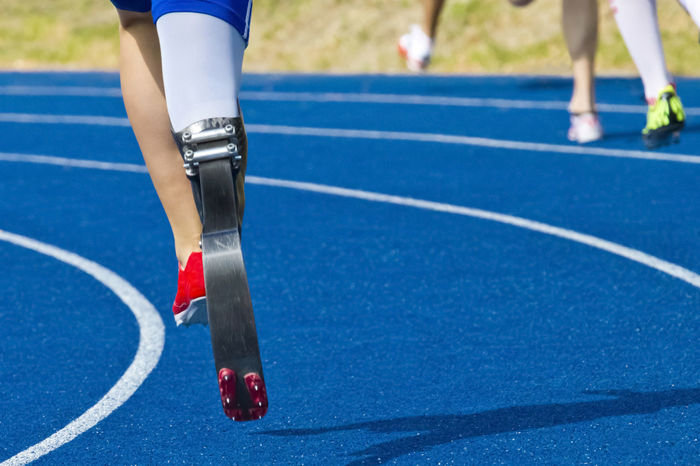 athlete with handicap on race track Amputation Athlete Blue Competition Competitive Sport Court Day Disabled Exercising Handicapped Accesible Human Body Part Human Leg Men One Person Outdoors Paralympics Professional Sport Prosthesis Running Track Skill  Sport Sports Race Sports Track Sportsman Track And Field Athlete