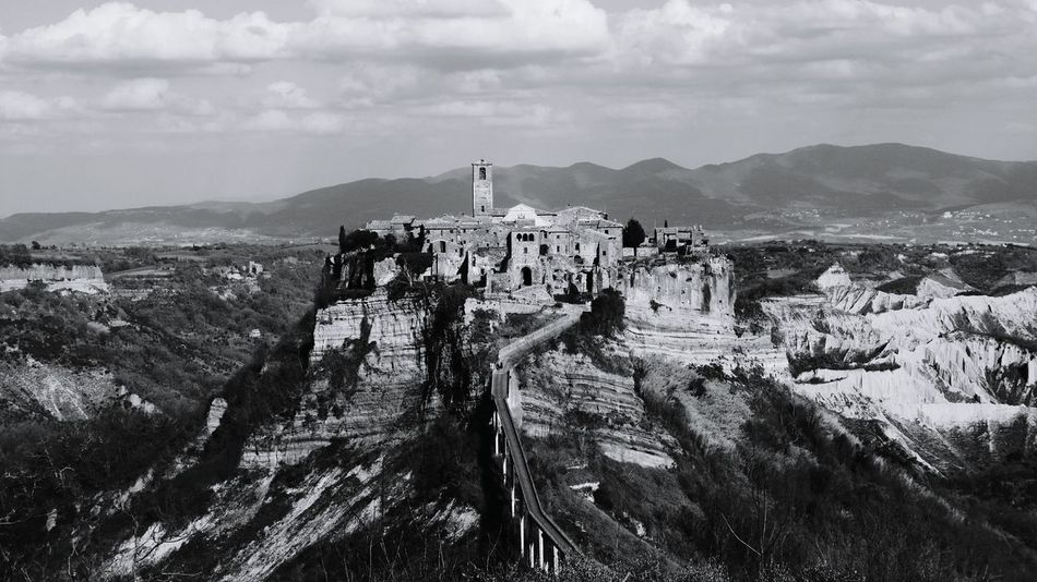 Civita Di Bagnoregio Mountain Mountain Range Cloud - Sky Beauty In Nature Sky Outdoors Men Nature Day Scenics Real People Only Men Adult Large Group Of People People