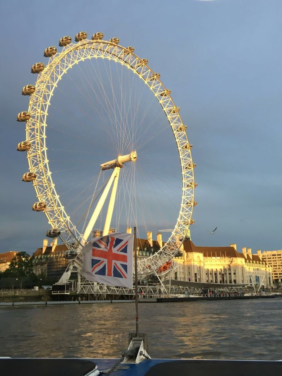 London Eye from the Thames Ferris Wheel Architecture Building Exterior Travel Destinations Cultures Built Structure City Outdoors Water Nautical Vessel Sky Bridge - Man Made Structure No People Day Big Wheel London London Eye Thames Thamesriver Flag