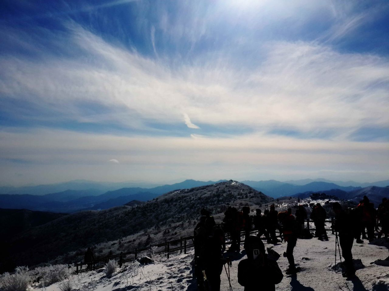 mountain, sky, nature, beauty in nature, snow, landscape, mountain range, cold temperature, cloud - sky, scenics, winter, real people, outdoors, tranquility, adventure, vacations, men, day, people