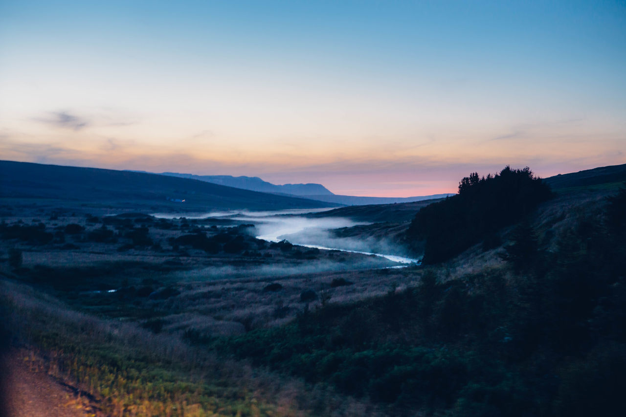 sunset, nature, beauty in nature, mountain, scenics, tranquil scene, landscape, sky, tranquility, outdoors, no people, water, grass, day