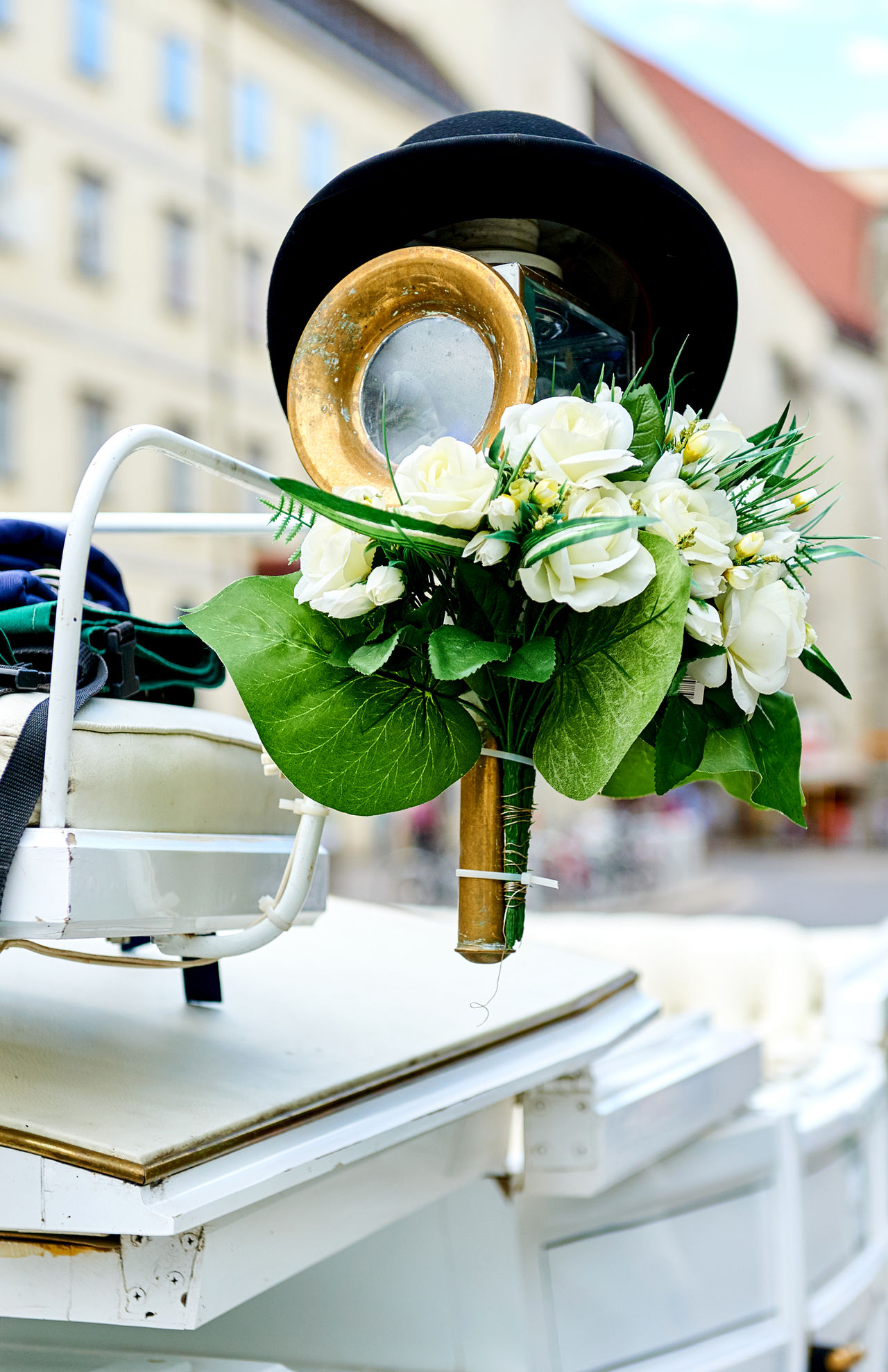 Element of a horse-drawn wedding carriage (Fiacre) in the old city of Vienna, Austria Austria Austrian Bouquet Cab Chariot Closeup Coach Detail Element Event Fiacre Fiaker Flower Holiday Horse-drawn Carriage Nobody Old Fashioned Outdoors Part Of Rentable Retro Styled Traditional Vienna Vintage Wedding