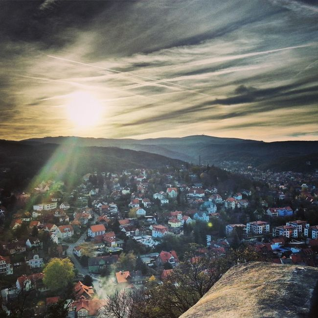 City Brocken Sun And Clouds