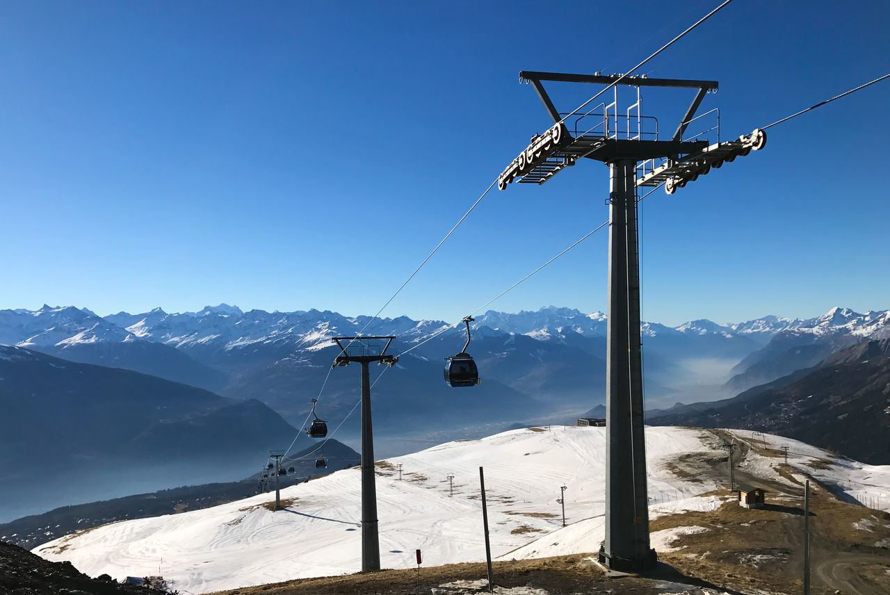 Cold Temperature Crans-Montana Cransmontana Extreme Terrain Funicular Landscape Mountain Nature No People Outdoors Ski Ski Lift Skiing Sky Snow Switzerland Tranquil Scene Winter Flying High