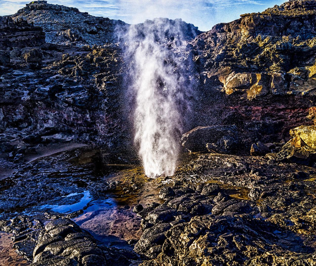 Geyser On Rock Formation
