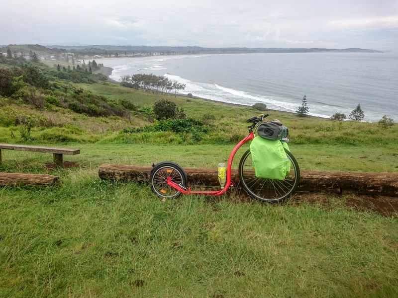 Kickbike parked looking out over beach on rainy day Beach Bicycle Grass Kickbike Land Vehicle No People Ocean Ocean View Outdoors Parked Rain Clouds Stationary Transportation
