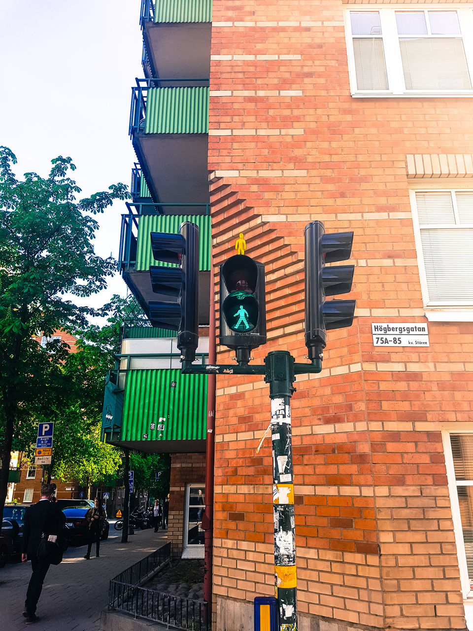 building exterior, traffic signal, traffic light, road sign, transportation, guidance, safety, outdoors, architecture, stoplight, day, built structure, low angle view, city, no people