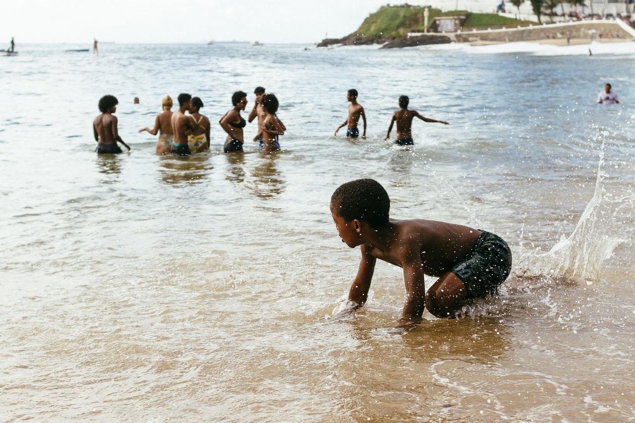 Bahia/brazil Beach Happiness Kids Being Kids Live For The Story Nature Outdoors Playing Porto Da Barra Real People Salvador Bahia Shirtless Vacations Water Waves Crashing