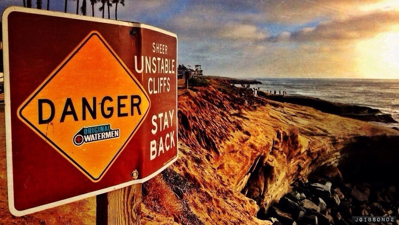text, communication, sky, horizon over water, no people, guidance, sea, outdoors, water, day, close-up, road sign, nature