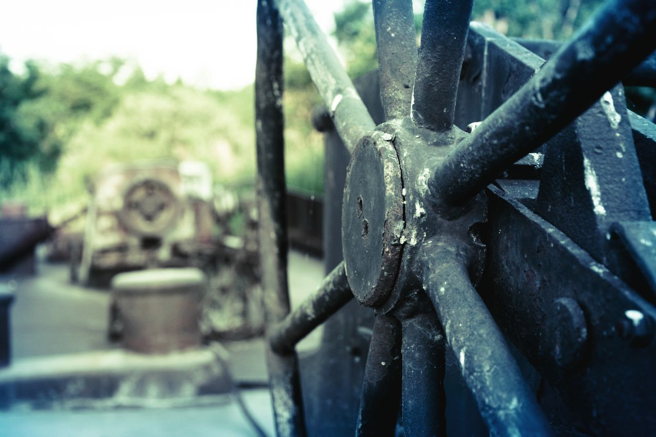 metal, machinery, rusty, wheel, close-up, machine part, no people, transportation, day, gear, focus on foreground, mode of transport, industry, valve, land vehicle, train - vehicle, outdoors, steam train, manufacturing equipment, factory, locomotive