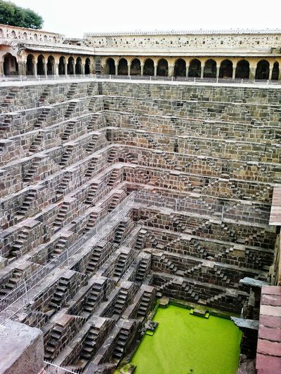 Stepwell with 3500 steps and 13 stories built in 800 AD Water Storage Water Harvesting Steps Stepwell ChandBaori Abhaneri Rajasthan India Heritage Site Ancient Architecture Pattern Architecture Ancient Pattern, Texture, Shape And Form Patterns & Textures Well  Chand Baori Amazing Architecture Amazing Place Art In Architecture Incredibleindia Incredible India Architectural Photography The Architect - 2016 EyeEm Awards