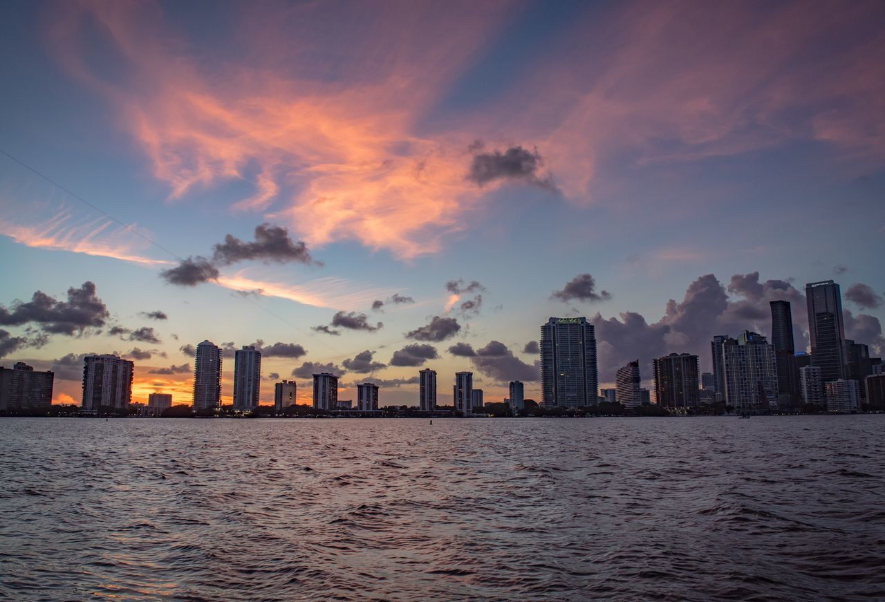 Skyscraper Cityscape Architecture City Building Exterior Urban Skyline Sunset Sky Downtown District Modern Waterfront Built Structure Sea Outdoors No People Travel Destinations Cloud - Sky Water Day