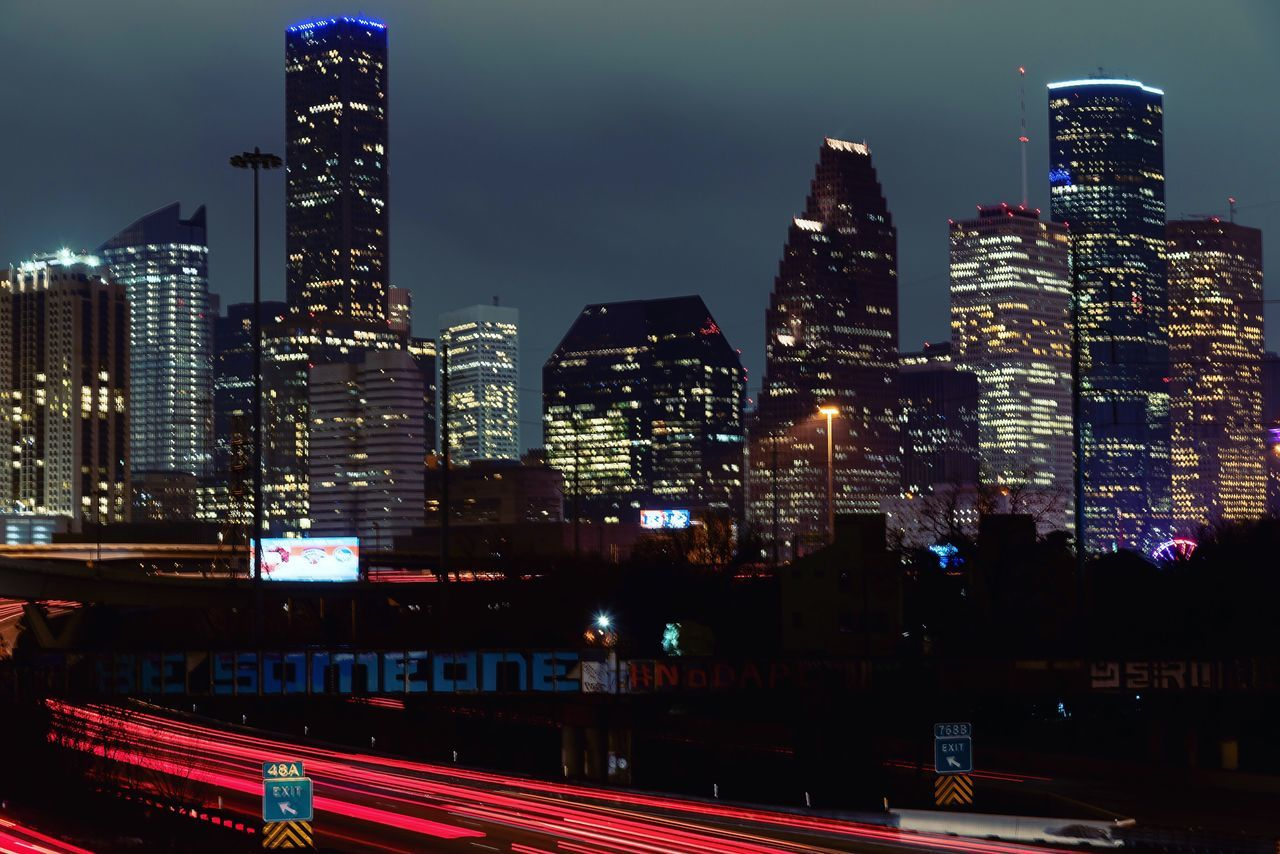 Downtownhou City Night Long Exposure Houston City Architecture Illuminated Building Exterior Night Skyscraper Built Structure Transportation Modern Urban Skyline Travel Destinations Cityscape Sky Road City Life Tall No People Outdoors