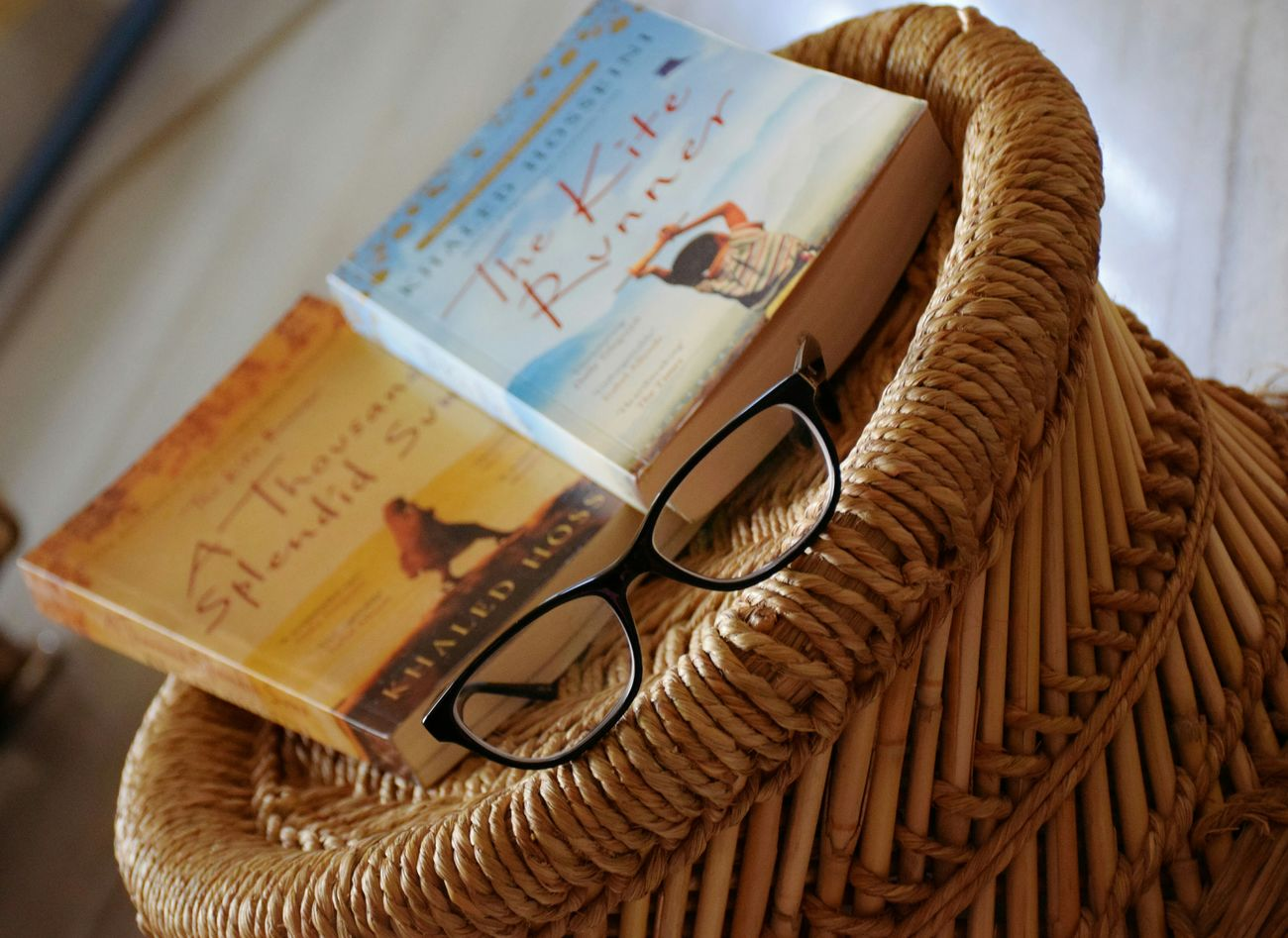 Two great books together and the third one need to be added to the list. KhalidHossaini The Kite Runner Thousand Splendid Suns Booklover Bookphotography Glasses 👓