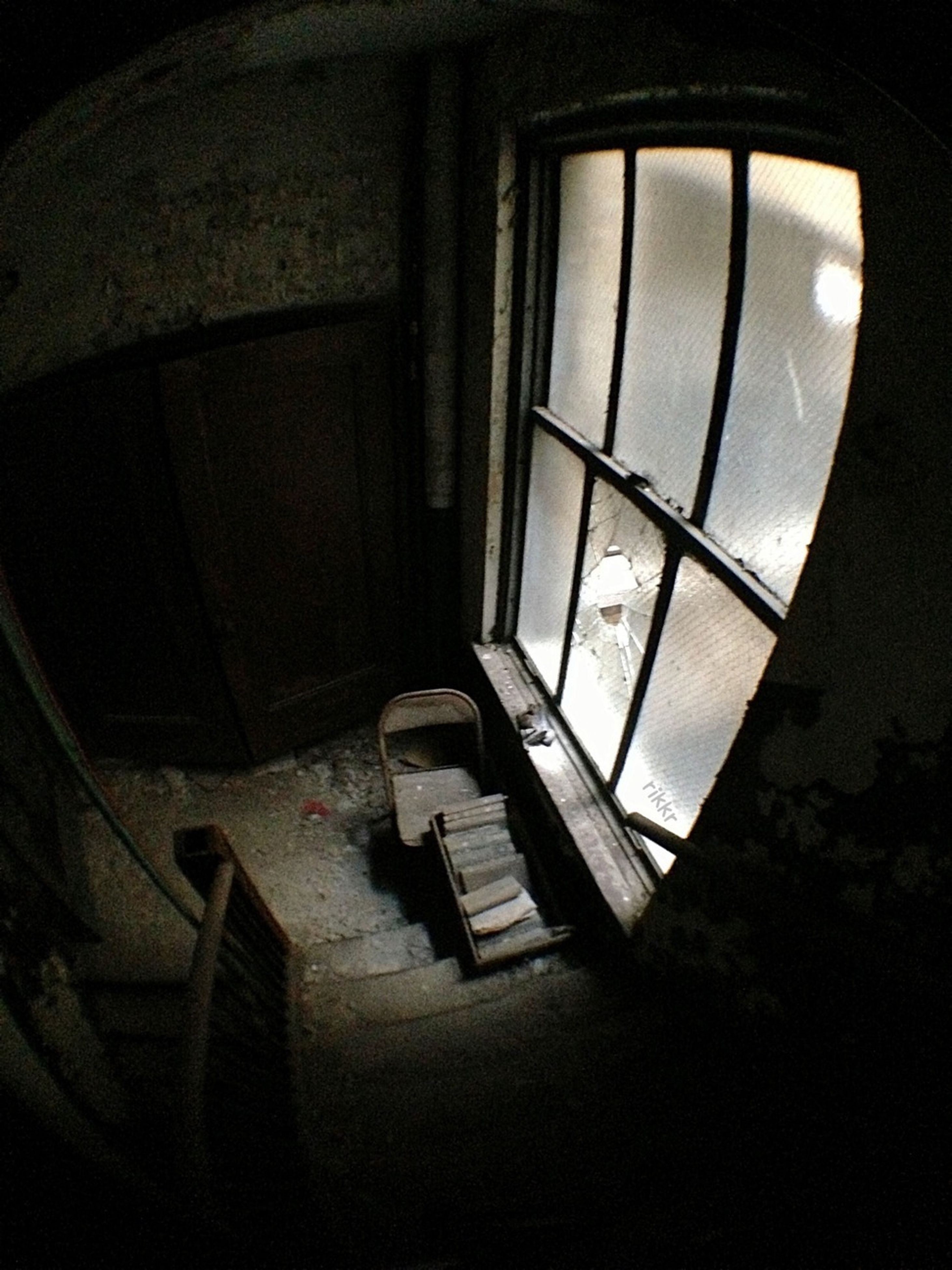 indoors, window, architecture, built structure, low angle view, interior, building, absence, no people, home interior, dark, wall - building feature, sunlight, empty, day, building exterior, wall, shadow, house, glass - material