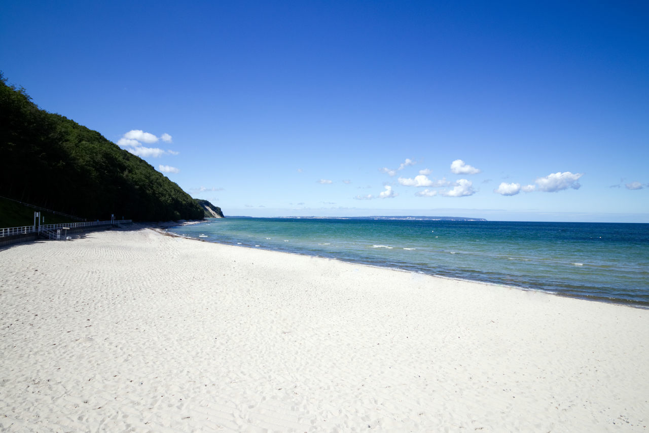 Rügen Rügen Lovers Beach Beauty In Nature Blue Clear Sky Day Germany Horizon Over Water Idyllic Nature No People Outdoors Sand Scenics Sea Sky Summer Tranquil Scene Tranquility Travel Destinations Tree Vacations Water Wave