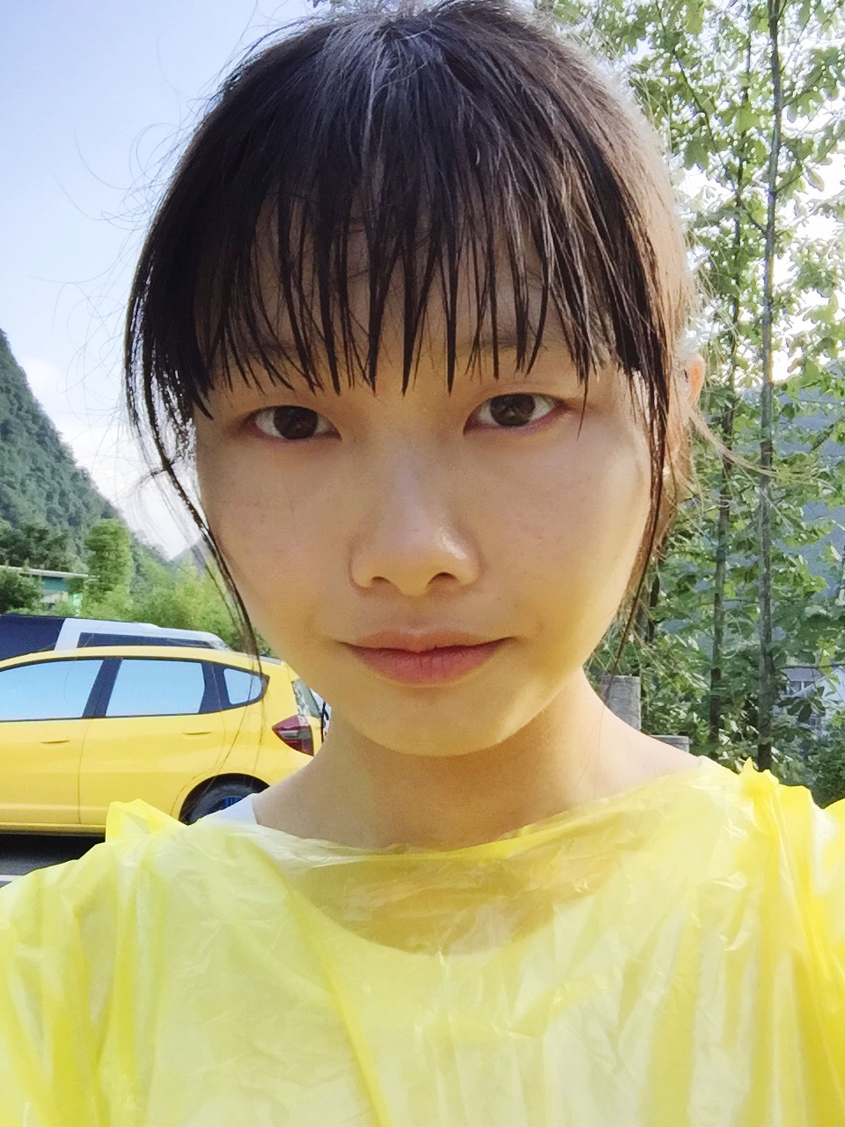 person, childhood, elementary age, lifestyles, headshot, looking at camera, portrait, cute, girls, innocence, leisure activity, close-up, front view, casual clothing, focus on foreground, boys, smiling, yellow